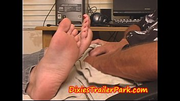 amazing blonde milf gives a nice foot job to her husband